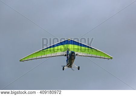 Ultralight Airplane Flying In A Blue Sky