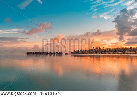Sunset On Maldives Island. Sunset On Maldives Island, Luxury Water Villas Resort And Wooden Pier, St