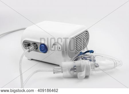 Ultrasonic Inhaler Or Nebulizer. Respiratory Medicine. Asthma Breathing Treatment With Oxygen Mask,