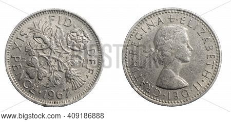 England Six Pence Coin On White Isolated Background