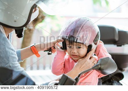 Sad Babies Feel Uncomfortable When Wearing A Helmet With Their Mother