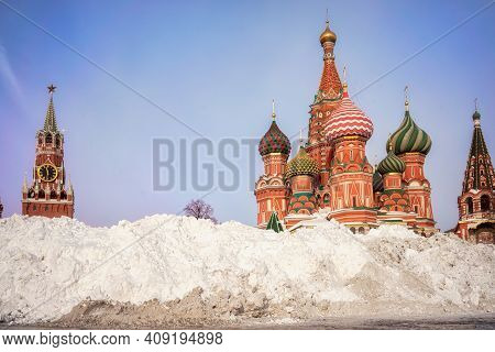 Snow Pile Near St. Basil's Cathedral And Spasskaya Tower. Winter In Moscow, Russia.