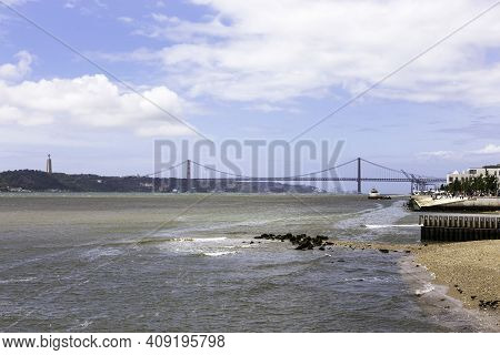 Panoramic View Of The Tagus River And The 25th Of April Bridge In Lisbon, Portugal
