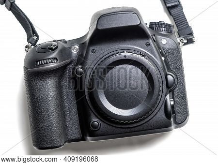 Photo Camera Isolated On White Background, Front View Of Professional Dslr Camera Body. Black Digita