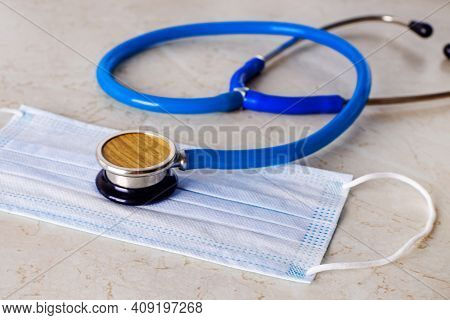 Stethoscope Lying On The Medical Masks. Concept Of Healthcare. Concept Of Quarantine Terms