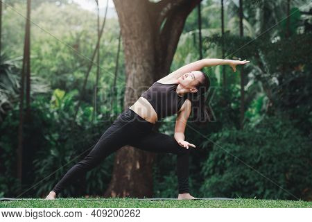 Asian Woman Practicing Yoga She Stretching Sideways To Start Preparing Of Prep Poses For Side Crane