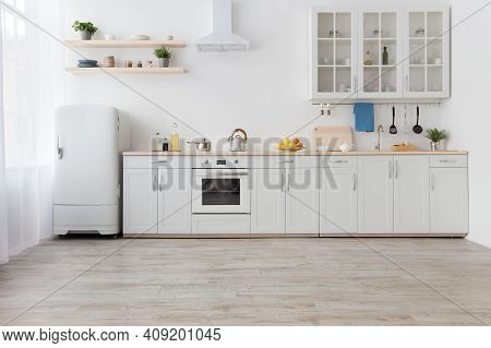 White Scandinavian Kitchen Interior With Dining Room And Wooden Floor. Simply Furniture With Utensil
