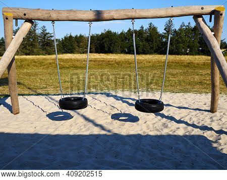 Simple Design But Lots Of Fun Swing Teeter-totter Made Of Wood And Old Tires  In A Playground