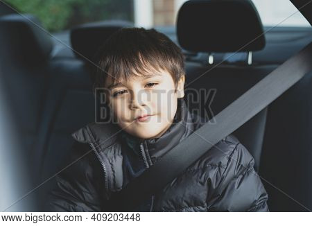Cinematic Portrait Boy Siting In Safety Car Seat Looking At Camera With Smiling Face,child Sitting I