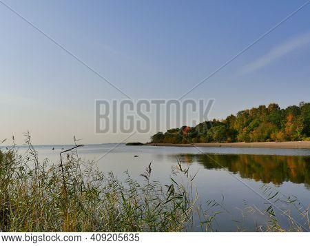 Beautiful Autumn Landscape Blue Sky Motley Forest Reflected In Water Quiet Morning At River