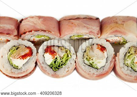 Sushi Roll With Bacon And Fried Sea Bass On A White Plate, Ingredients Fried Sea Bass, Cream Cheese,