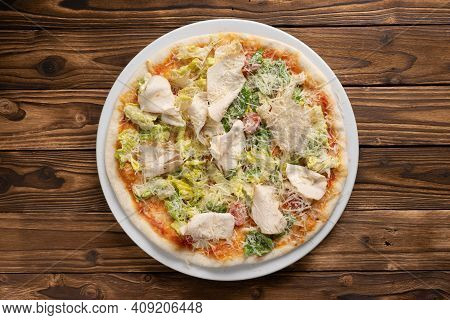 Caesar Pizza On Thin Dough With Chicken Breast, Lettuce, Cherry Tomatoes And Parmesan Cheese In A Wh