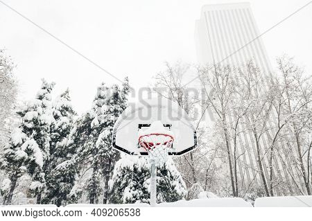 Front View Of A Street Basketball Hoop Under The Snow During The Heavy Filomena Storm In Madrid, Spa