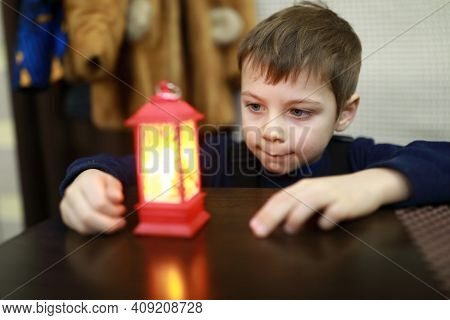 Child Looking At Small Lamp In Cafe