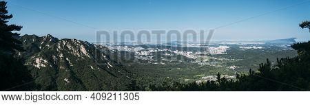 Panoramic View From The Mountain Tops In Bukhansan National Park, Seoul, South Korea, With Buildings
