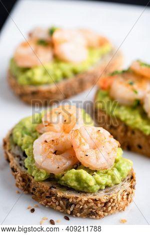 Toast With Avocado And Shrimps On Multigrain Bread. Healthy Shrimp Avocado Appetizer
