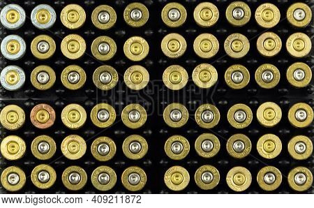 Pistol Cartridges In The Storage Cells Of Cartridges, The Background Of Pistol Cartridges.
