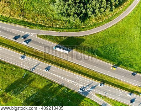 Aerial Top Down View Of A Highway Road Intersection. Cars Passing, Highway Junction, Cross Roads.