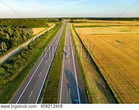 Aerial View Of A Highway Road. Cars Passing, Highway Junction, Cross Roads.