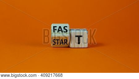 Time To Fast Start Symbol. Turned A Wooden Cube With Words 'fast Start'. Beautiful Orange Table, Ora