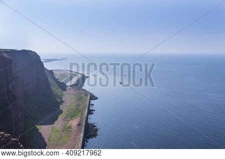 Beautiful Rocky Coastline With Sea And Blue Sky Long Anna On Helgoland Island In Germany.