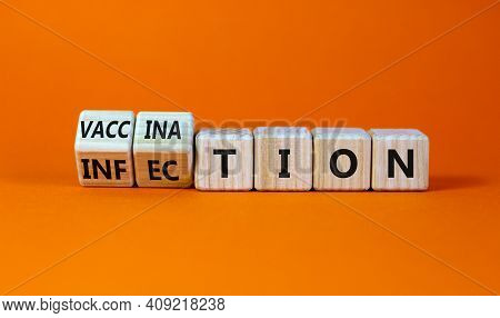 Vaccination Vs Infection Symbol. Turned Wooden Cubes And Changed The Word 'infection' To 'vaccinatio