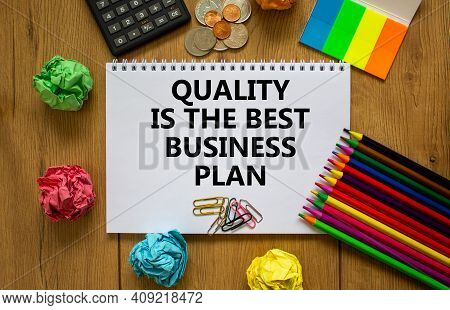 Quality Symbol. White Note With Words 'quality Is The Best Business Plan' On Beautiful Wooden Table,