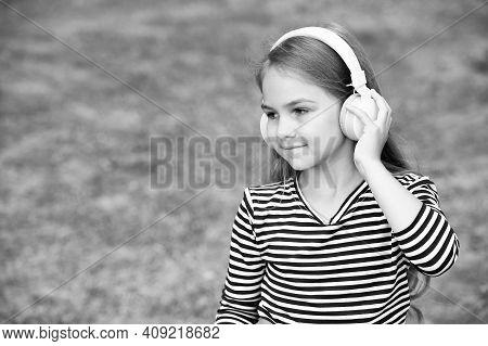Language Is New Life. Little Child Wear Headphones Summer Outdoors. English School. Language Educati
