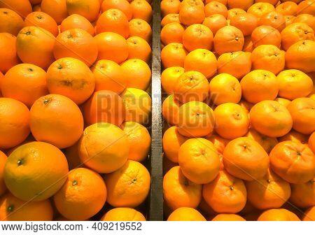 Fresh Orange Fruit Or Mandarin Fruit On Fresh Market. Oranges On Stall In The Mall, Oranges Backgrou