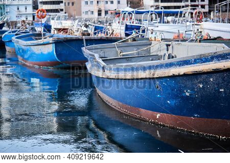 Background - Partially Blurred Small Blue Fishing Boats In The Harbor
