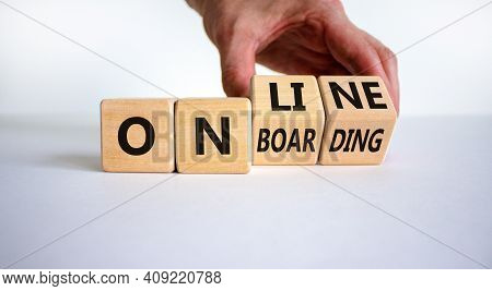 Online Onboarding Symbol. Businessman Turns Wooden Cubes With Words 'online Onboarding'. Beautiful W