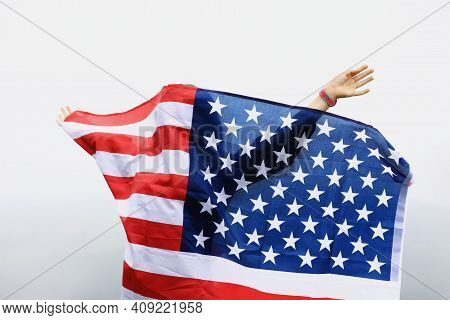 Adorable Little Girl Smiling And Waving American Flag. Patriotic Holiday. Happy Kid, Cute Little Chi