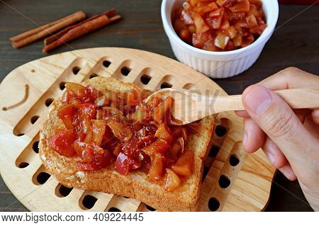 Hand Topping A Whole Grain Toast With Delectable Homemade Apple Cinnamon Compote