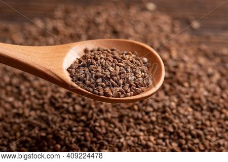 Anise Seeds In A Wooden Spoon. Spice. Lots Of Dry Anise Seeds.