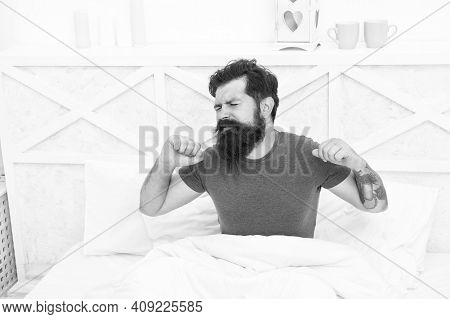 Morning Sleepiness. Peaceful Mature Male Relaxing. Bearded Man Stretching In Bed. Sleepy Guy Relax I