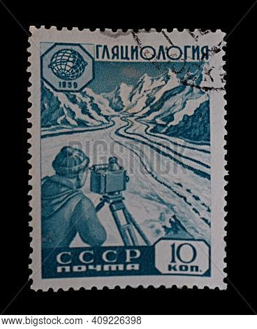 Bakhmut, Ukraine, February, 2021. Postage Stamp Of The Ussr, 1959. The Glaciologist Makes Geodetic M