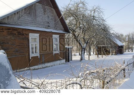 Old Wooden House Covered With Fresh Fallen Snow. Uninhabited Old Winter Cozy Cottage In Empty Villag