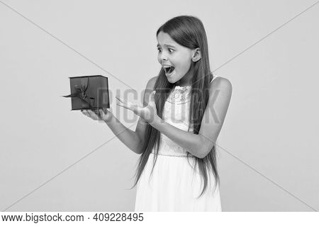 It Is Too Small. Happy Childhood. Surprised Little Girl Hold Gift Box. Boxing Day. Small Child On Ye