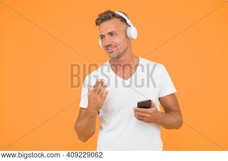 Favorite Music Playlist. Music Subscription. Man Listen Music Modern Headphones And Smartphone. List