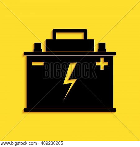 Black Car Battery Icon Isolated On Yellow Background. Accumulator Battery Energy Power And Electrici
