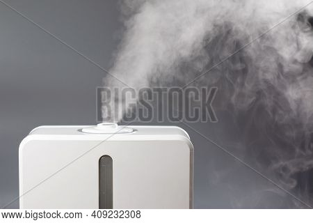 White Steam Of Ultrasonic Humidifier. Frume Of Vapor From Diffuser For Air Moisturize. Smoke For Hum