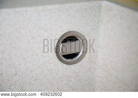 The Overflow For The Gray Sink In The Washbasin Is Gray Made Of Artificial Marble. Plumbing Bathroom