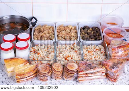 Prepared Meal Delivery Concept. Assorted Ready-to-eat Dishes On The Kitchen Table. Healthy Eating.
