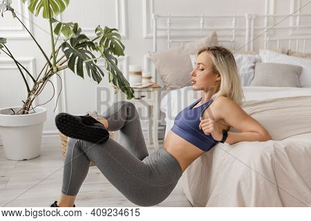 Sportive Blonde Girl In Gray Sportswear, Bra And Leggings Goes In For Sports, Does Back Push-ups Fro