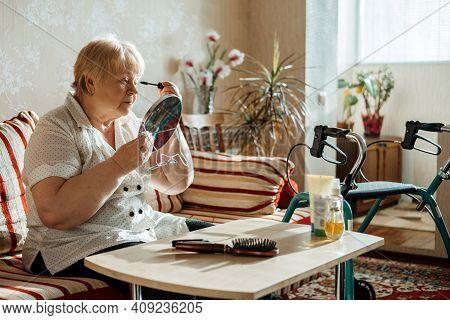 Senior Beauty And Skincare. Senior Elderly Plus Size Blonde Woman With Disability Applying Black Mas