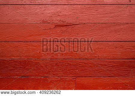 Background Of Vintage Barn Siding Painted Red With Peeling Paint And Nail Heads Visible