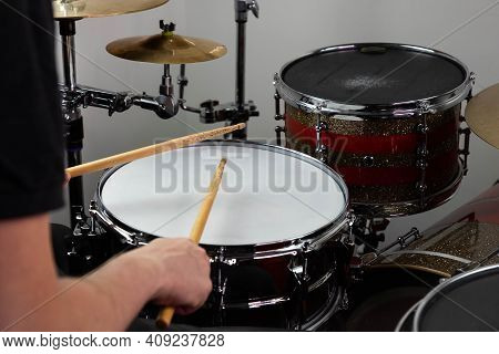 Professional Drum Set Closeup. Man Drummer With Drumsticks Playing Drums And Cymbals, On The Live Mu