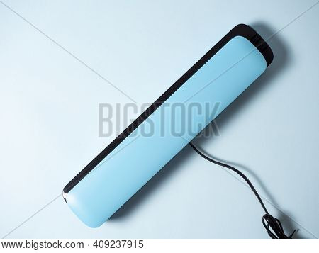Close-up Of A Blue Vacuum Packer Isolated On A Bright Blue Background. Machine To Preserve The Fresh