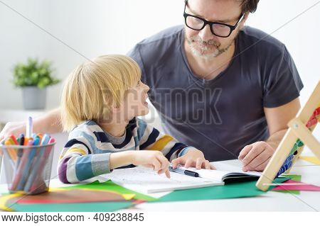 Father Helping Child Do His Homework At Home. Homeschooling, Distance Learning, Online Studying, Rem