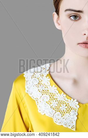 Close-up Of Part Close-up Of Part Of Face Of Woman In Yellow Blouse On Gray Isolated Backgroundof Fa